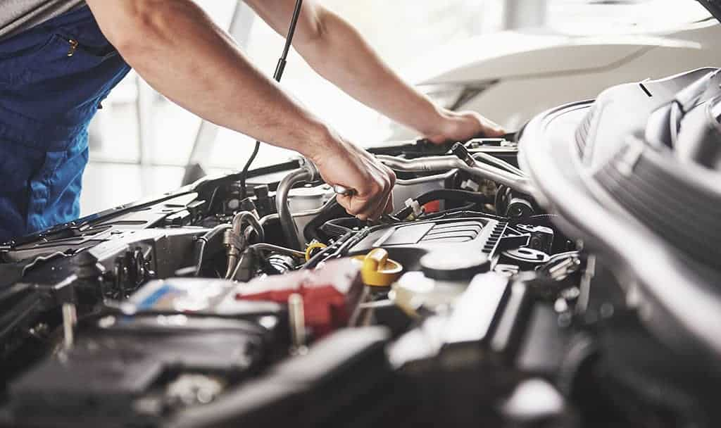 Our Mechanic Performing a Tune-Up on a Customer's Vehicle
