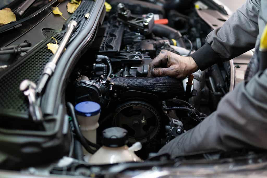 Our technician performing an engine repair at our shop in Mays Landing, NJ.
